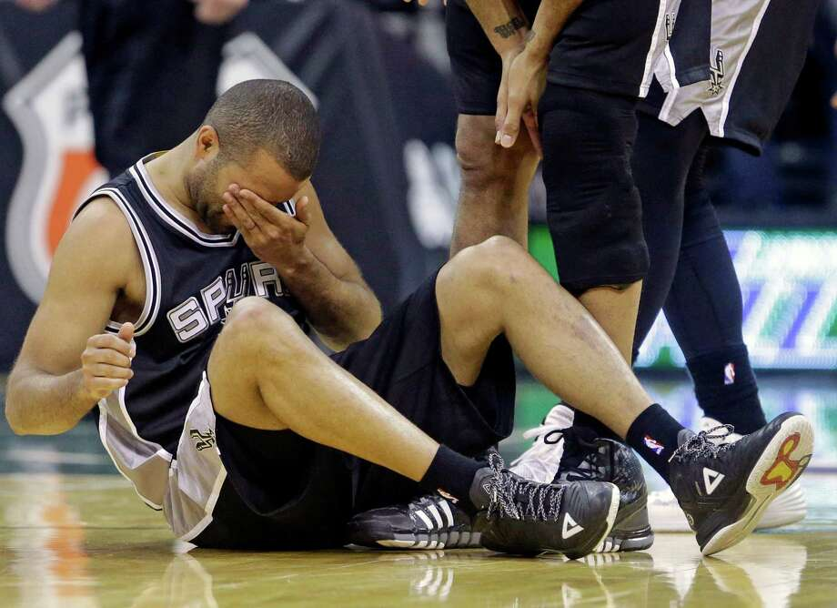 Spurs guard Tony Parker holds his face after a collision in the second half against the Utah Jazz. Photo: Rick Bowmer /Associated Press / AP