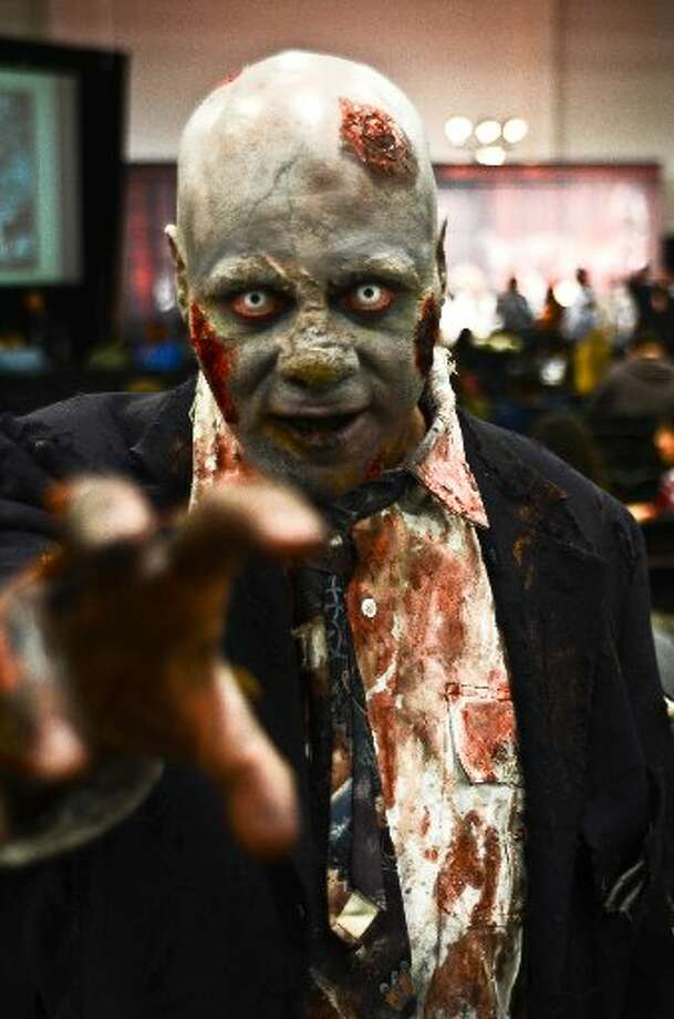 Peeling skin, unhealed wounds, creepy penetrating eyes and a slow, staggering gait are sure signs of zombie infection.