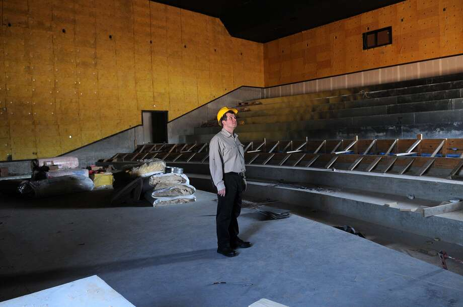 Showbiz Cinemas general manager Joseph Tucker is leading the renovation of the Kingwood location, 350 Northpark Drive. The cinema will have a superior digital experience, according to the company,  as well as a party room and plush  seating. Photo: Jerry Baker, Freelance