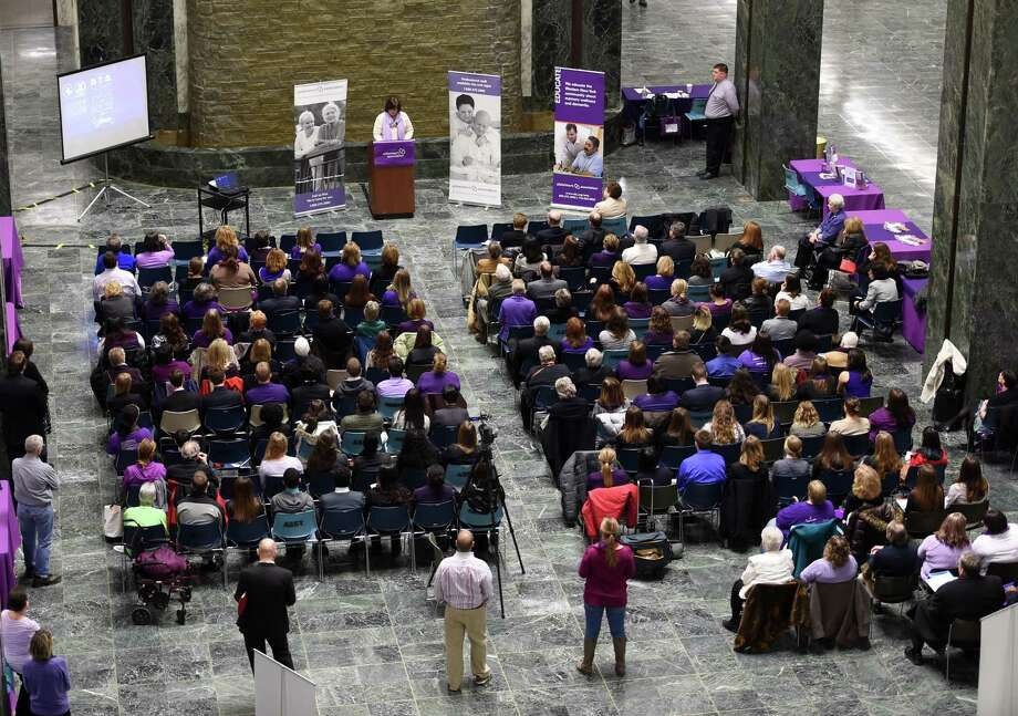 Alzheimer's Association advocates gather in the well of the Legislative Office Building Tuesday morning Feb. 24, 2015 in Albany, N.Y,  to lobby lawmakers in their quest for greater funds for caregiver respite in the new State budget.  (Skip Dickstein/Times Union) Photo: SKIP DICKSTEIN / 00030732A