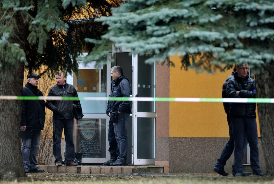 Police officers investigate killings at a restaurant where a gunman opened fire in the town of Uhersky Brod. Photo: Dalibor Gluck / McClatchy-Tribune News Service / Zuma Press
