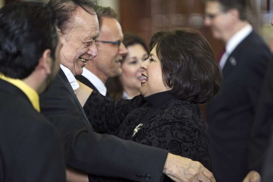 State Senator Leticia Van De Putte is greeted by Flaco Jimenez who was on hand for a recognition ceremony before the senator gave her farewell speech on the Senate floor Tuesday,  February 24, 2015 Photo: San Antonio Express-News