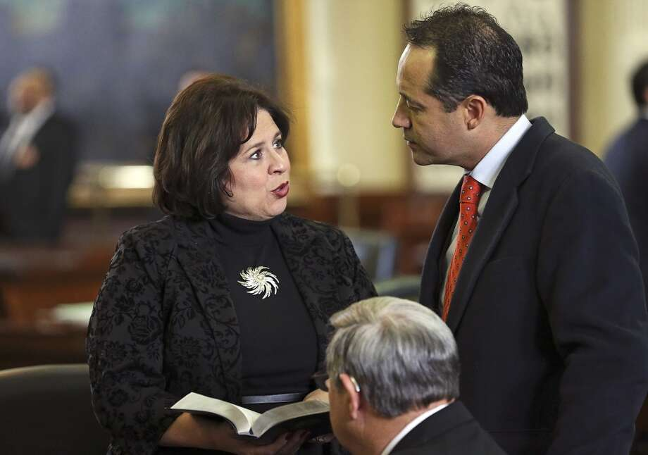 State Senator Leticia Van De Putte explains a notation she entered in her desk Bible to be left for her replacement, Jose Menendez, before she gives her farewell speech on the Senate floor Tuesday,  February 24, 2015 Photo: San Antonio Express-News