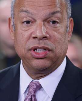 US Homeland Security Secretary Jeh Johnson speaks during a press conference at the US Citizenship and Immigration Services Headquarters on February 23, 2015, in Washington, DC.