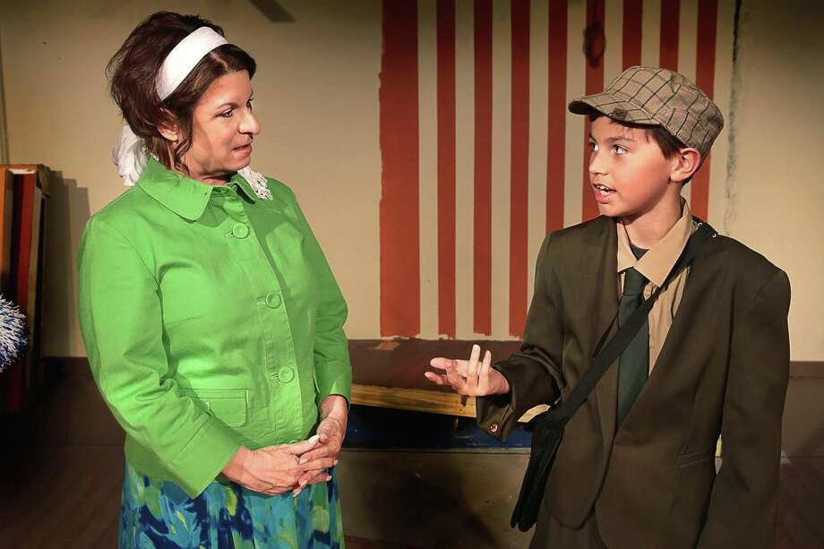 """Mrs. Antrobus and the Telegraph Boy, played by Carol Davis of Memorial and  Andrew Nurre of Katy, rehearse a scene from Theatre Southwest's """"The Skin of Our Teeth.""""      Mrs. Antrobus and the Telegraph Boy, played by Carol Davis of Memorial and  Andrew Nurre of Katy, rehearse a scene from Theatre Southwest's """"The Skin of Our Teeth."""" Photo: Theatre Southwest"""