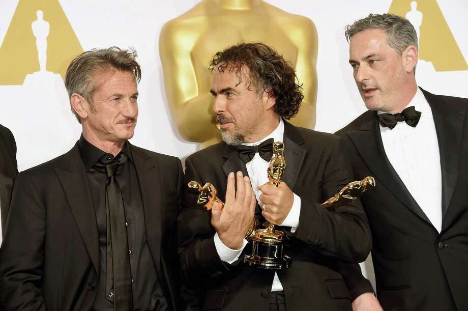 "A reader condemns actor Sean Penn (left) for a remark he made when presenting the Oscar to Alejandro González Iñárritu (center), producer/director of ""Birdman,"" which won four Academy Awards. At the right is producer John Lesher. Photo: Jason Merritt /Getty Images / 2015 Getty Images"