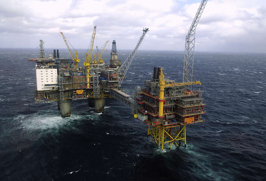 An aerial file photo shows the Oseberg oil platform in the Norwegian sea. After a decade of an oil and gas boom, plunging energy prices are shaking the Norwegians out of a Utopian reverie that guaranteed workers lengthy summer vacations, generous health and social benefits and allowed them to leave work at 4 p.m. and even earlier on Fridays. (AP Photo/NTB Scanpix, Helge Hansen, File) Photo: Helge Hansen / Associated Press / NTB Scanpix