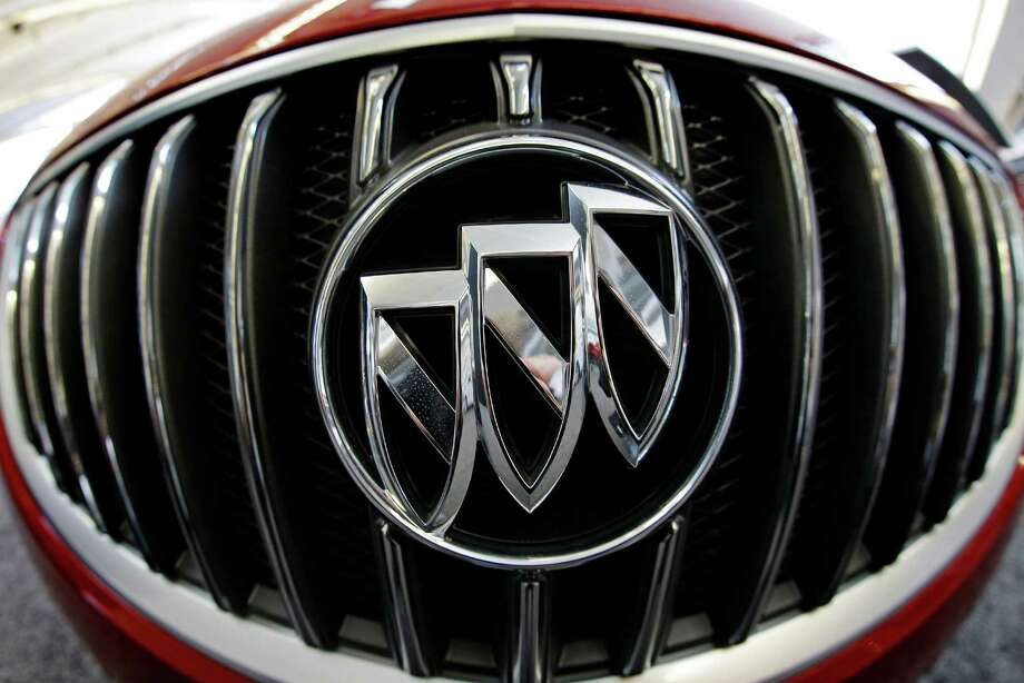 FILE - In this Feb. 14, 2013 file photo taken with a fisheye lens shows the Buick logo on the grill of a 2013 Buick Regal on display at the Pittsburgh Auto Show in Pittsburgh. Buick is the first U.S.-based automotive brand to crack the top 10 in Consumer Reports magazine's annual brand report cards, released Tuesday, Feb. 24, 2015. (AP Photo/Gene J. Puskar, File) Photo: Gene J. Puskar, STF / AP