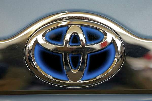 FILE - This Feb. 14, 2013 file photo shows the Toyota logo on the trunk of a Toyota automobile at the Pittsburgh Auto Show in Pittsburgh. Toyota placed third on Consumer Reports magazine's list of top auto brands, which was released Tuesday, Feb. 24, 2015. (AP Photo/Gene J. Puskar, File)