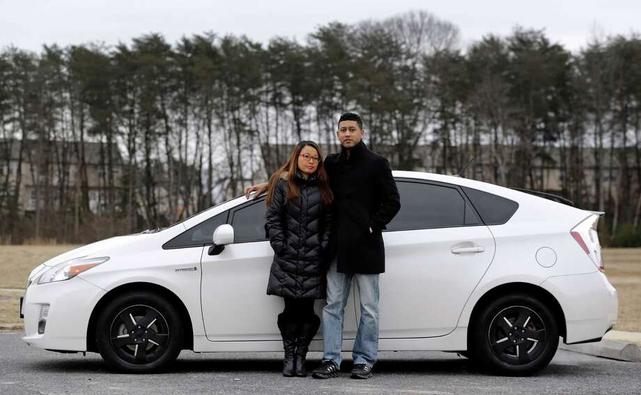 Eri and John Castro bought their 2011 Toyota Prius in Glen Burnie, Md. The Castros purchased the  pre-owned car last year, only to find out after they got it home that it was under recall because it could stall. Photo: Patrick Semansky, STF / AP