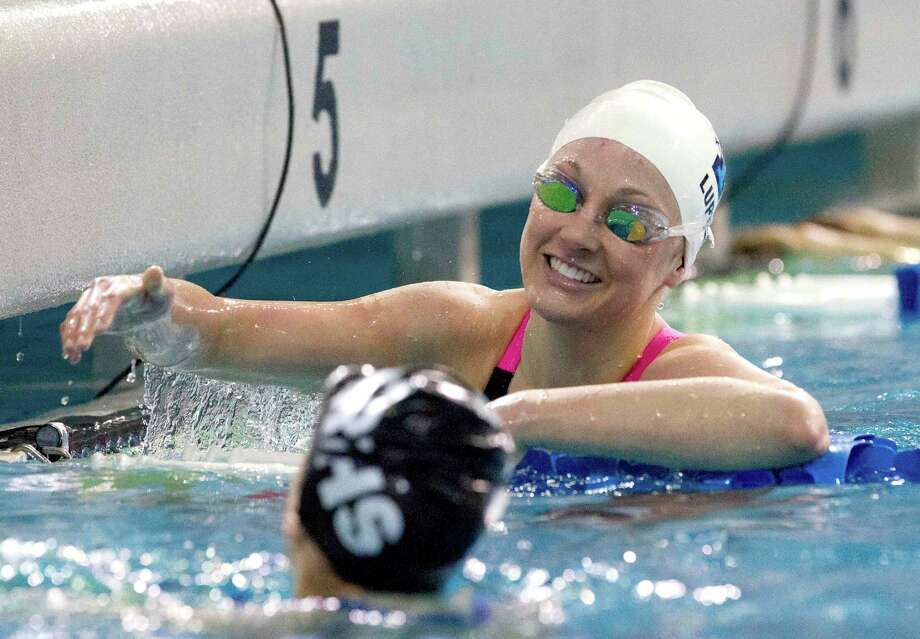 Kingwood's Alexandra Lupton smiles after winning the girls' 100-yard freestyle during the finals of the Class 6A UIL state meet. Photo: Jason Fochtman, MBR / Conroe Courier