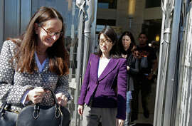 Ellen Pao (center) and one of her attorneys, Therese Lawless (left), leave the courthouse for during a break. She is suing Kleiner Perkins Caufield & Byers.