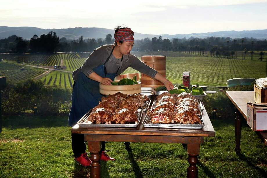 Visiting chef Masayo Funakoshi from Kyoto, Japan preps duck before roasting it at an event at Scribe winery in Sonoma. Photo: Liz Hafalia / The Chronicle / ONLINE_YES
