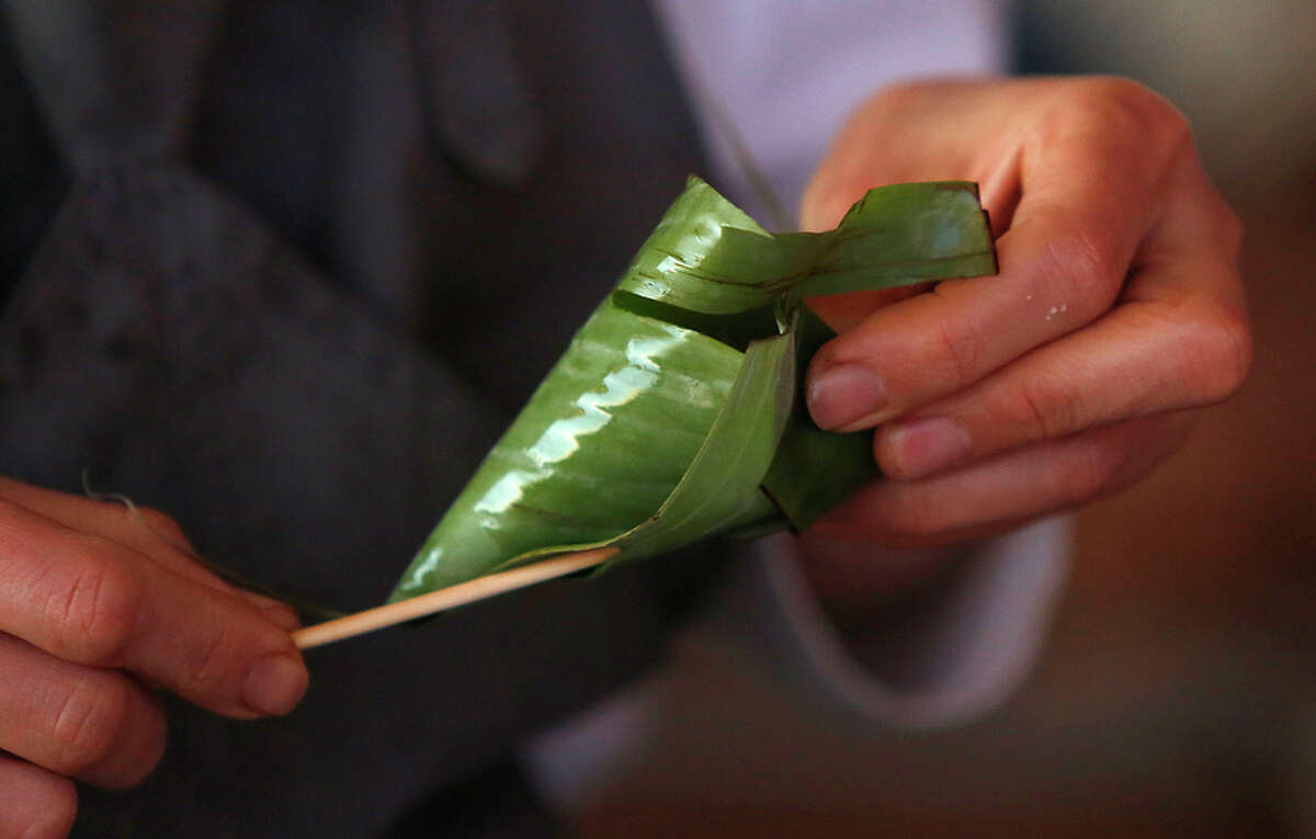 Banana leaves are rolled to carry rice for a wine club event at Scribe winery in Sonoma.