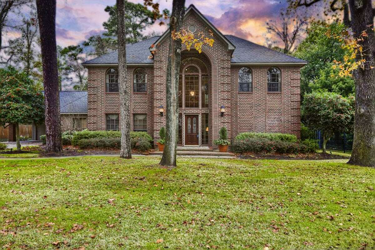 Humble: Four-bedroom custom-built home has an oversize master suite, an upstairs game room and, on the large patio, a fire pit and outdoor kitchen. 3,848 square feet