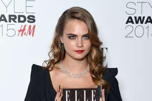 Cara Delevingne with her Breakthrough Actress award during the Elle Style Awards 2015 at Sky Garden @ The Walkie Talkie Tower on February 24, 2015 in London, England.  (Photo by Gareth Cattermole/Getty Images)