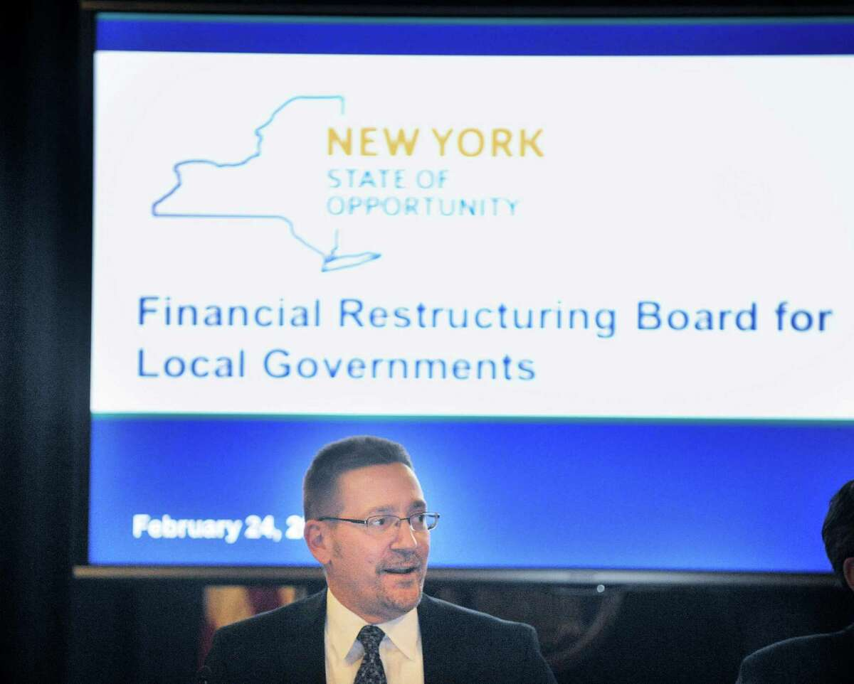 Todd Scheuermann, from the State Division of Budget, addresses those gathered as board members take part in a meeting of the Financial Restructuring Board of Local Governments at the Capitol on Tuesday, Feb. 24, 2015, in Albany, N.Y. The board released their recommendations for several cities in the state. (Paul Buckowski / Times Union)