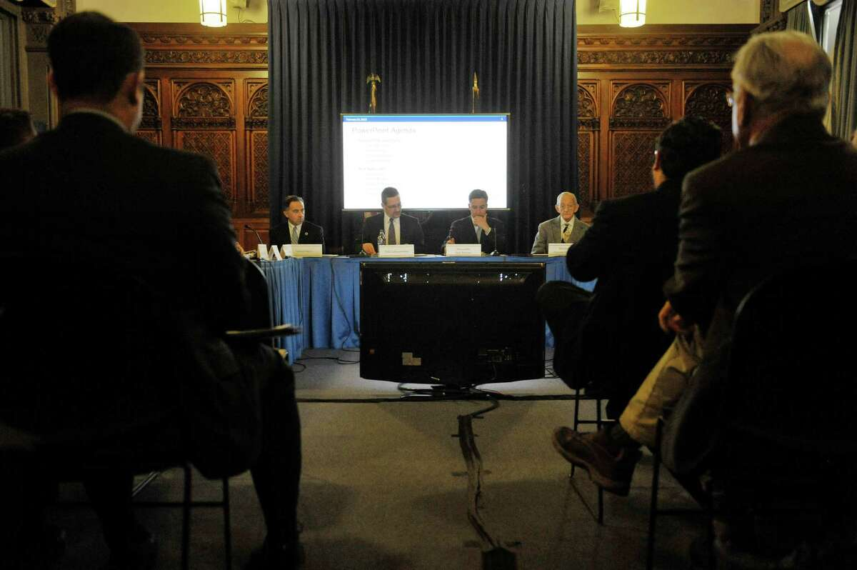 Board members take part in a meeting of the Financial Restructuring Board of Local Governments at the Capitol on Tuesday, Feb. 24, 2015, in Albany, N.Y. The board released their recommendations for several cities in the state. (Paul Buckowski / Times Union)