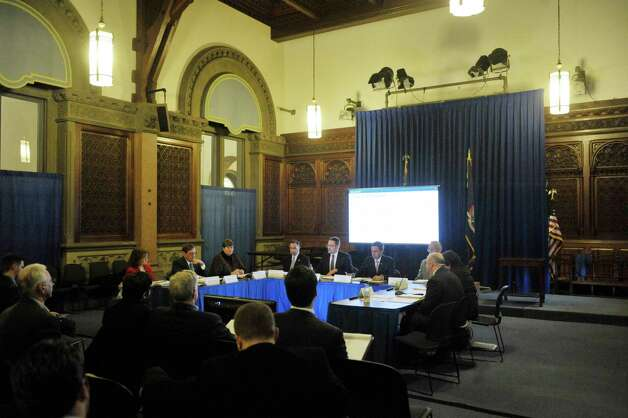 Board members take part in a meeting of the Financial Restructuring Board of Local Governments at the Capitol on Tuesday, Feb. 24, 2015, in Albany, N.Y.  The board released their recommendations for several cities in the state.   (Paul Buckowski / Times Union) Photo: PAUL BUCKOWSKI / 00030725A