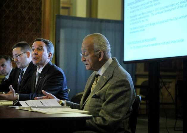 Board members, Todd Scheuermann, left, from the State Division of Budget, Senator Jack Martins, center, and Assemblyman Herman Farrell, Jr., take part in a meeting of the Financial Restructuring Board of Local Governments at the Capitol on Tuesday, Feb. 24, 2015, in Albany, N.Y.  The board released their recommendations for several cities in the state.   (Paul Buckowski / Times Union) Photo: PAUL BUCKOWSKI / 00030725A