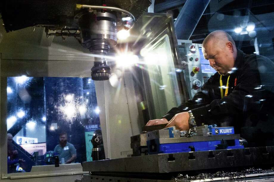 Jon Noble prepares a Haas VF-3YT/50 vertical machining center for a demonstration at the HOUSTEX 2015 manufacturing trade show. Photo: Marie D. De Jesus, Staff / © 2015 Houston Chronicle