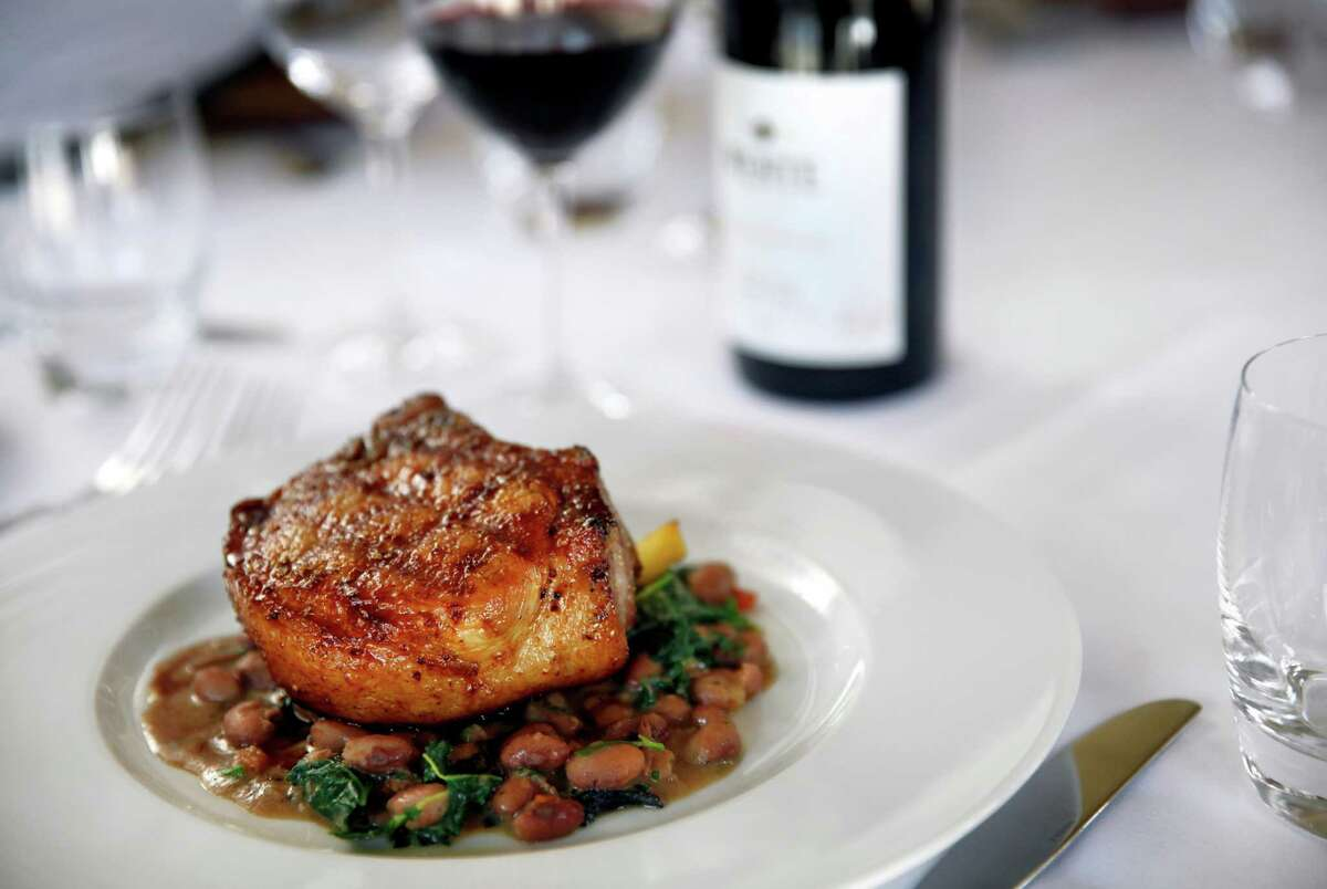 The pork chop is one of the most popular dishes at the Restaurant at Wente Vineyards in Livermore. The restaurant has been in business for 29 years.