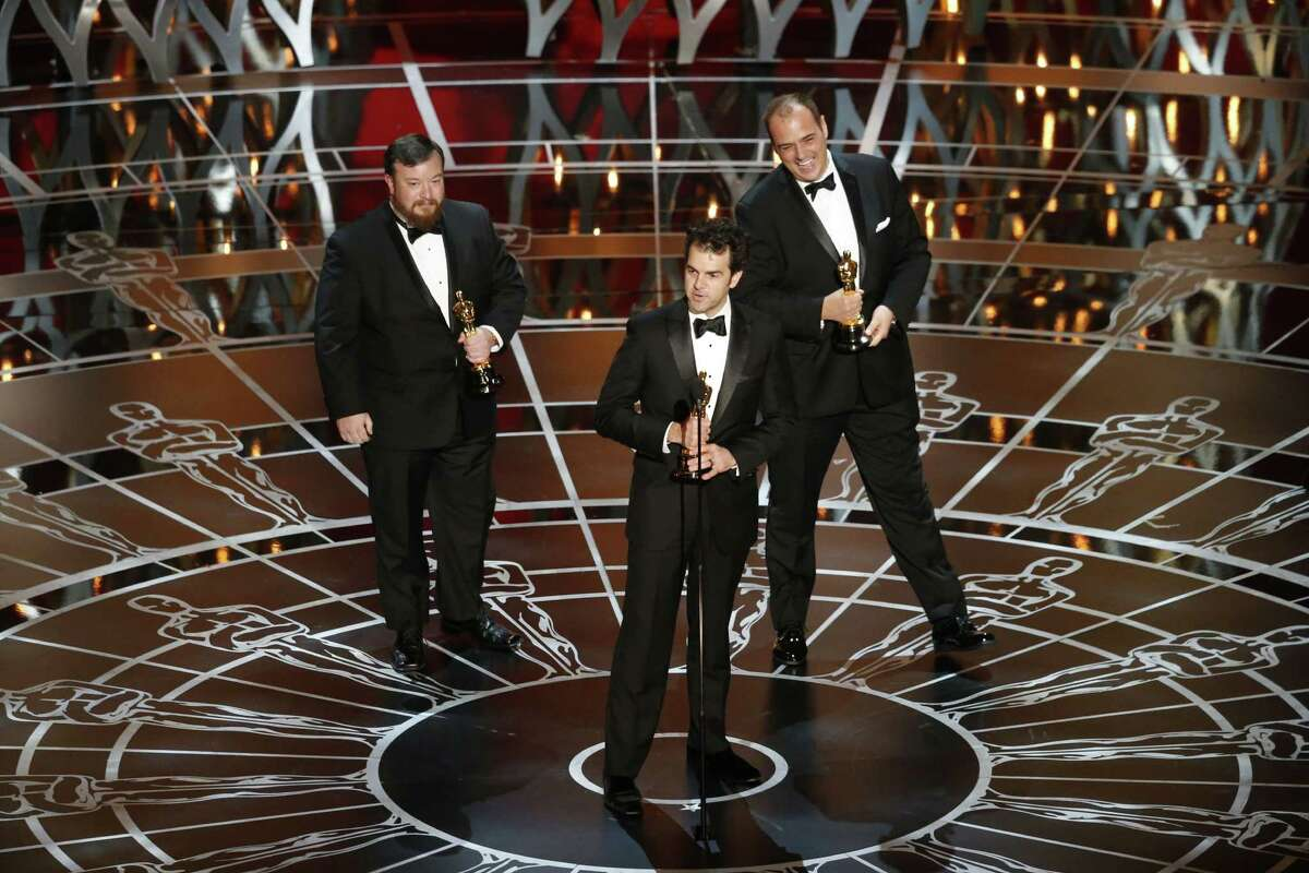"""From left: Thomas Curley, Craig Mann and Ben Wilkins accept Oscars for best sound mixing for their work on """"Whiplash"""" during the 87th Academy Awards ceremony at the Dolby Theatre in Los Angeles, Feb. 22, 2015. (Patrick T. Fallon/The New York Times) ORG XMIT: XNYT190"""