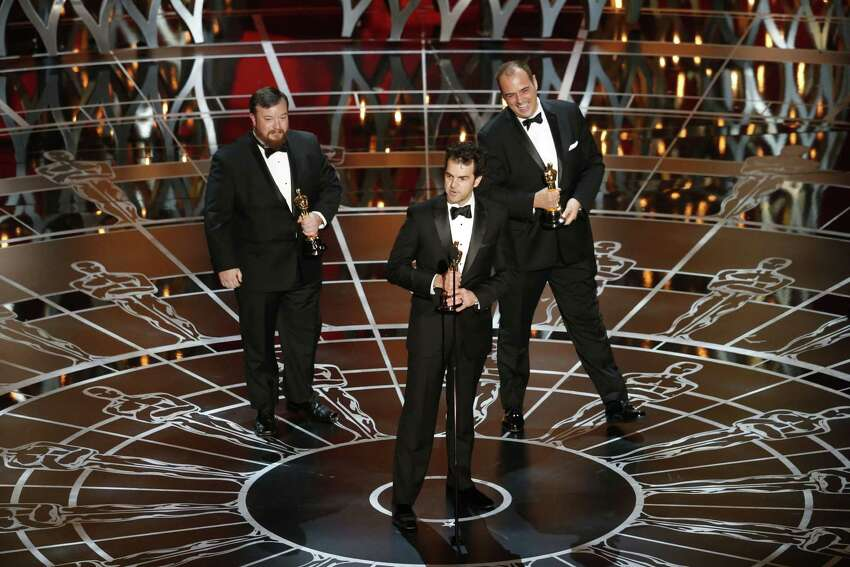From left: Thomas Curley, Craig Mann and Ben Wilkins accept Oscars for best sound mixing for their work on