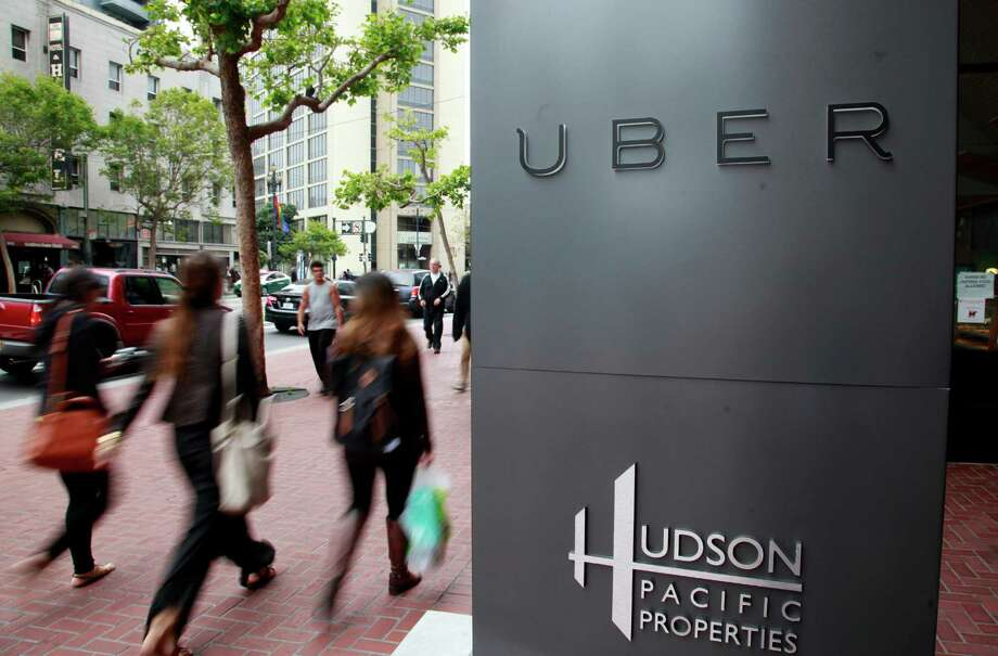 Foot traffic streams past Uber offices on Market Street Monday evening, June 2, 2014 in San Francisco, Calif. The urban tech boom is transforming much the long-blighted mid-Market area. (Karl Mondon/Bay Area News Group/TNS) Photo: Karl Mondon, MBR / McClatchy-Tribune News Service / Contra Costa Times