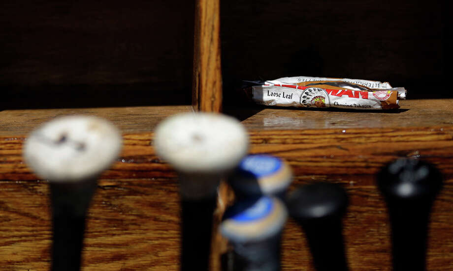 Chewing tobacco is banned in minor-league baseball, but it is still a common sight in major-league dugouts. Photo: Matt Slocum / AP / ONLINE_CHECK