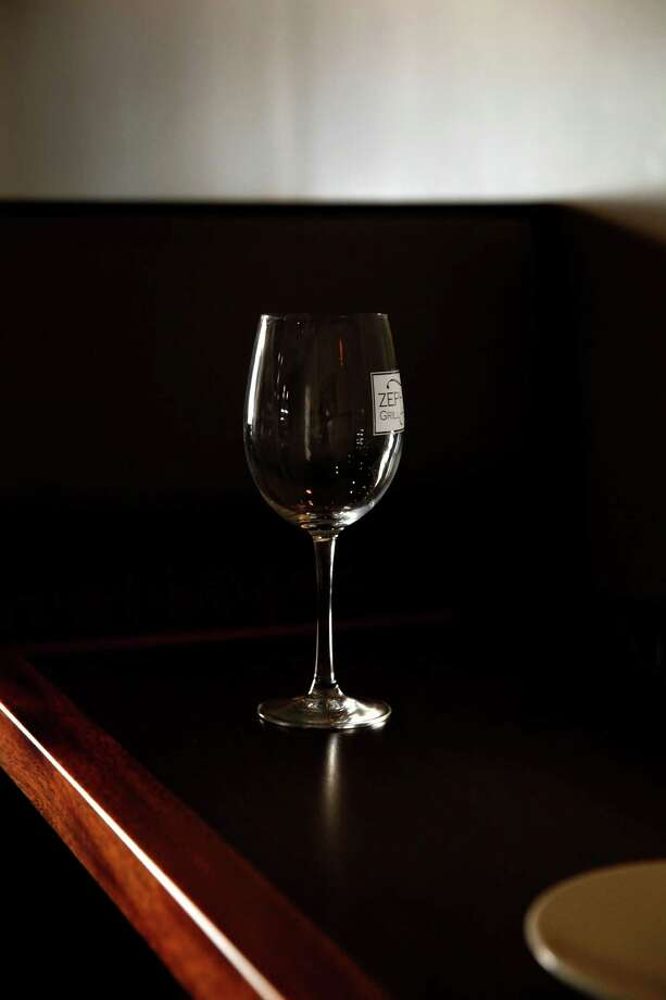 A wine glass at Zephyr Grill and Bar in Livermore where the Secret Sommelier recently visited. A woman who calls herself the Secret Sommelier has been going into area restaurants and surprising random diners with free bottles of Livermore-produced wines. Photo: Preston Gannaway / Special To The Chronicle / ONLINE_YES