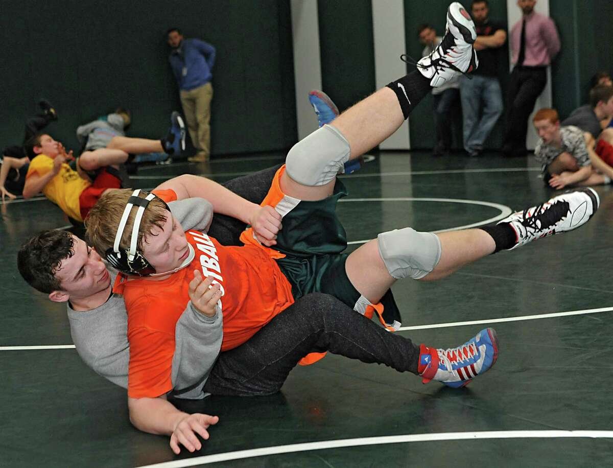 Hoosick Falls wrestler Nolan Foster, left, practices with his teammate Garrett Wright for the state tournament with other area wrestlers during media day at Shenendehowa High School on Monday Feb. 23, 2015 in Clifton Park, N.Y. (Lori Van Buren / Times Union)