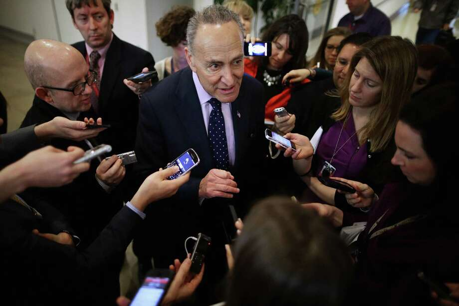 WASHINGTON, DC - FEBRUARY 24:  Sen. Charles Schumer (D-NY) (C) talks with reporters after a news conference about the possible shutdown of the Department of Homeland Security at the U.S. Capitol February 24, 2015 in Washington, DC. Democrats have successfully blocked the $39.7 billion funding legislation because it would also strip away the executive actions in which President Barack Obama eased the deportation threat for several million undocumented immigrants. If Republicans and Democrats can not work around the impasse then 30,000 DHS employees will go home February 28 and 200,000 more will work without paychecks until a solution is found.  (Photo by Chip Somodevilla/Getty Images) ORG XMIT: 539693291 Photo: Chip Somodevilla / 2015 Getty Images