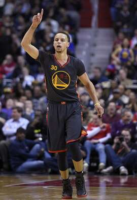 Golden State Warriors guard Stephen Curry (30) gestures after he scored during the first half of an NBA basketball game against the Washington Wizards, Tuesday, Feb. 24, 2015, in Washington. (AP Photo/Nick Wass)