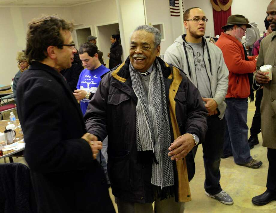 Ed Gomes, a candidate for a senate seat in the 23rd District, in center, shakes hands with supporter Zalman Nakhimovsky, during a victory celebration at his election headquarters on East Main Street in Bridgeport, Conn. on Tuesday Feb. 24, 2015. Photo: Christian Abraham / Connecticut Post