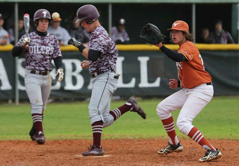 Dobies pitcher Jacob Limas (12) waits for the throw while Pearlands Jake Orlando (19) scores on a pass ball in the 7th inning in a high school baseball game on Tuesday February, 24,2015 in Houston, TX. Pearland won 10 to 0. Photo: Thomas B. Shea, For The Chronicle / © 2014 Thomas B. Shea