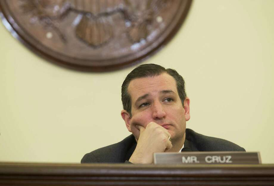 """U.S. Sen. Ted Cruz broke an awkward silence as Aldrin's phone buzzed, saying: """"Just tell us if that's a call from the space station."""" Photo: SAUL LOEB /AFP / Getty Images / AFP"""