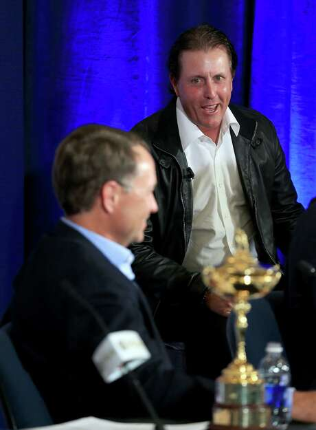 Phil Mickelson, right, an outspoken critic of previous Ryder Cup captain Tom Watson, was on hand Tuesday for the selection of Davis Love III. Photo: David Cannon, Staff / 2015 Getty Images