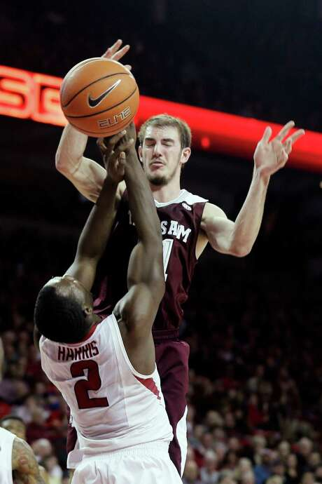 Arkansas' Alandise Harris deflects an Alex Caruso pass during a first half in which A&M struggled. Photo: Danny Johnston, STF / AP