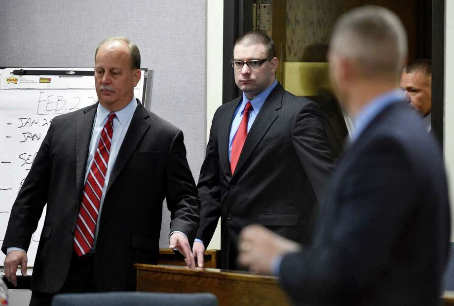 Former Marine Cpl. Eddie Ray Routh, center, enters the court for his capital murder trial at the Erath County, Donald R. Jones Justice Center in Stephenville Texas, on Tuesday, Feb. 24, 2015. Routh, 27, of Lancaster, is charged with the 2013 deaths of Chris Kyle and his friend Chad Littlefield at a shooting range near Glen Rose, Texas. Photo: Michael Ainsworth, AP / Pool The Dallas Morning News