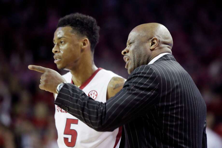 Arkansas coach Mike Anderson, right, talks to Arkansas's Anthlon Bell in the first half of in Fayetteville, Ark., Tuesday, Feb. 24, 2015. The Razorbacks beat Texas A&M 81-75 in an SEC game. Photo: Danny Johnston /Associated Press / AP