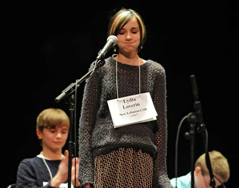 Seventh grader Lydia Loverin spells the word occludent correctly to win the Capital Region Spelling Bee at Proctors on Tuesday, Feb. 24, 2015 in Schenectady, N.Y.  (Lori Van Buren / Times Union) Photo: Lori Van Buren / 00030397A