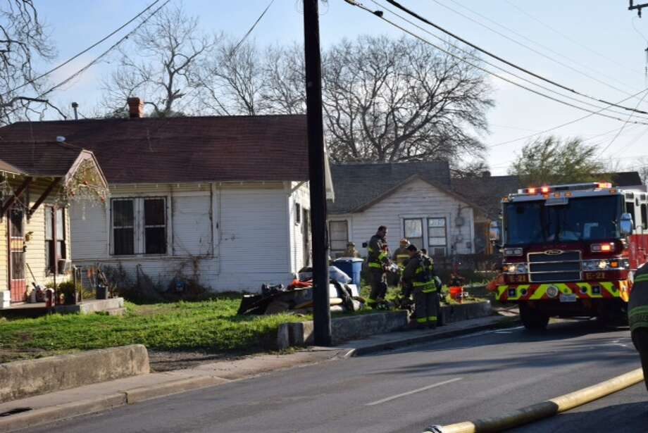 San Antonio firefighters battled a house fire on the South Side of the city February 25, 2015. Photo: Mark D. Wilson/San Antonio Express-News
