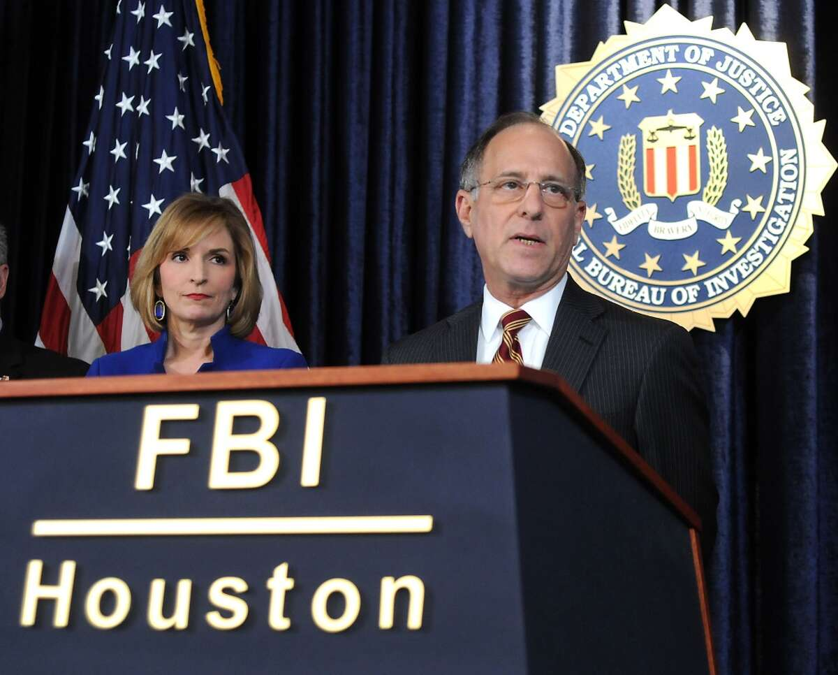 Federal prosecutor vows justice. U.S. Attorney Kenneth Madison speaks on the recent armored car robbery and murder of Brinks Armored Guard Alvin Kinney during a news conference at the FBI's Houston Division Monday. A $100,000 reward is being offered for information leading to the capture of the killers.(Dave Rossman Photo)