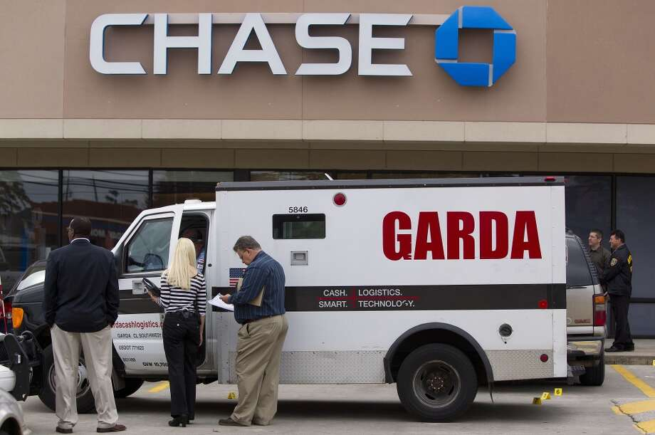 Police investigate an attempted robbery of an armored truck guard outside a Chase bank at the 4700 block of Louetta Road near Kuykendahl Road on Oct. 22, 2013. Photo: Johnny Hanson, Houston Chronicle