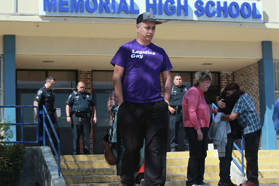 Carlos Soto (center) leaves Memorial High School Wednesday February 25, 2015 after transgender student Jayden Blake Castillo,18, spoke with the media about school district policy regarding trans students.