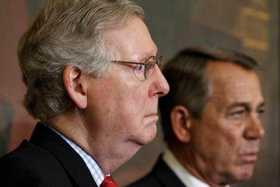 Senate Majority Leader Mitch McConnell, R-Ky., (left) and Speaker of the House John Boehner, R-Ohio, stand together at a ceremony before the signing of the bill authorizing expansion of the Keystone XL pipeline on Feb. 13.
