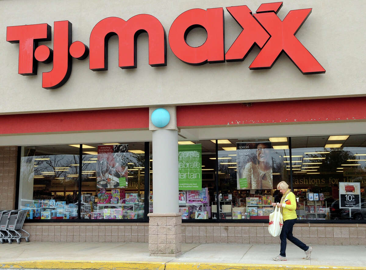 FILE - In this Nov. 17, 2009 file photo, a customer walks past a T.J. Maxx store in Boston. TJX Cos., the owner of T.J. Maxx, Marshalls and Home Goods stores, on Wednesday, Feb. 25, 2015 said it will boost pay for U.S. workers to at least $9 per hour. (AP Photo/Lisa Poole, File)