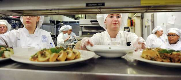 Culinary students work the line in the kitchen at the Casola Dining Room on Wednesday, Feb. 18, 2015, at Schenectady County Community College in Schenectady, N.Y. (Cindy Schultz / Times Union) Photo: Cindy Schultz / 00030647A
