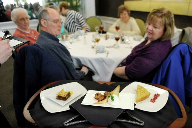 Guests consider the dessert choices at the Casola Dining Room on Wednesday, Feb. 18, 2015, at Schenectady County Community College in Schenectady, N.Y. (Cindy Schultz / Times Union) Photo: Cindy Schultz / 00030647A